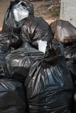 Pile of full black garbage bags outdoor Royalty Free Stock Image