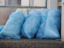 A pile of full garbage bags in a dump Royalty Free Stock Photo