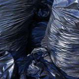 Pile of full garbage bags Stock Images