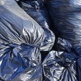 Pile of full garbage bags Stock Image