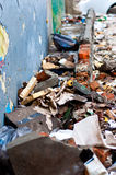 Pile of garbage. And rubble next to a blue wall Royalty Free Stock Images