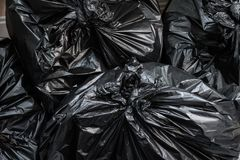 A pile of garbage bags. Trash bags background stock images