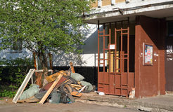 Pile of garbage at the entrance of an apartment house. Balashikha. Moscow region. A big garbage heap in the street at the entrance of multi-storey residential Royalty Free Stock Photo