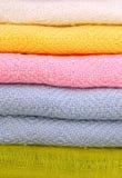 Pile of gentle folded shawls (scarfs) royalty free stock photo