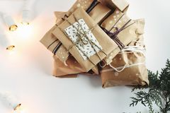 A pile of gift boxes in craft eco paper, handmade presents on wh stock image