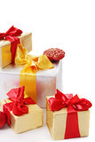 Pile of gift boxes with red and golden ribbon Stock Image