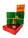 Pile of gift boxes of various sizes and colors isolated on white Stock Photos