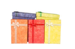 Pile of gift boxs with ribbon and bow isolated on white Royalty Free Stock Images