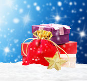 Pile of gifts on snow Stock Photography