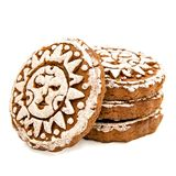 Pile of gingerbread with white glazing in sun shape isolated on white with clipping path. Pile of rounds gingerbread with white glazing in sun shape isolated on Stock Images