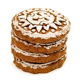 Pile of gingerbread with white glazing in sun shape isolated on white with clipping path. Pile of rounds gingerbread with white glazing in sun shape isolated on Royalty Free Stock Images