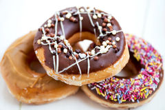 Pile of Glazed Doughnuts with colourful sprinkles, chocolate, ic Royalty Free Stock Photo