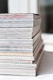 Pile of glossy magazines. The pile of glossy magazines on the table Royalty Free Stock Photo