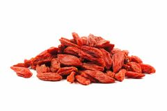 Pile of goji berries over white Stock Photos