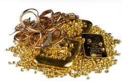 A pile of gold bars, gold jewelry and gold granules. Isolated on white background. stock photos