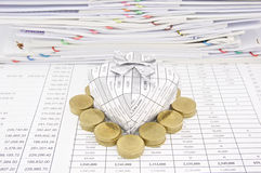 Pile of gold coin around gift box Stock Images