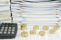 Pile of gold coins with calculator Royalty Free Stock Photo