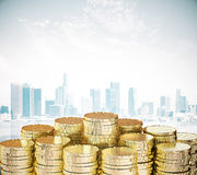 Pile of gold coins at city background Royalty Free Stock Photo