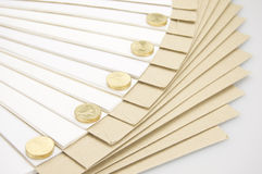 Pile of gold coins on step paperwork and envelope Stock Photography