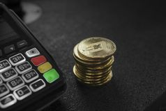 A pile of gold Dash Crypto currency coins and POS terminal. Dashes Cryptocurrency. E-commerce, business, finance concept. Banking and payment stock images