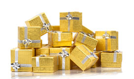 A pile of gold gifts on white Stock Photos