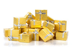 A pile of gold gifts on white Stock Image