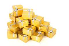 A pile of gold gifts on white Royalty Free Stock Photography