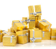 A pile of gold gifts on white Royalty Free Stock Images