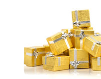 A pile of gold gifts on white Stock Photo