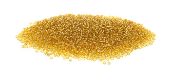 Pile of gold glass beads Stock Photography