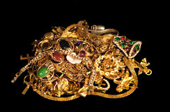 Pile Of Gold Jewelry On Black Royalty Free Stock Photos