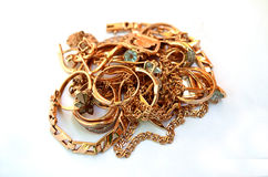 Pile of gold jewelry. On white background royalty free stock photography