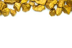 A pile of gold nuggets or gold ore on white background, precious stone or lump of golden stone, financial and business concept. Idea royalty free stock image