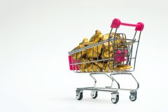 Pile of gold nuggets or gold ore in shopping cart or supermarket. Trolley on white background, precious stone or lump of golden stone, financial and business stock photos