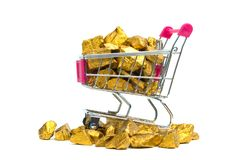 Pile of gold nuggets or gold ore in shopping cart or supermarket trolley on white background, precious stone or lump of golden. Stone, financial and business royalty free stock photos