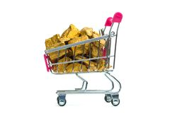 Pile of gold nuggets or gold ore in shopping cart or supermarket trolley on white background, precious stone or lump of golden. Pile of gold nuggets or gold ore stock image