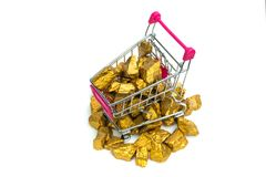 Pile of gold nuggets or gold ore in shopping cart or supermarket trolley on white background, precious stone or lump of golden. Pile of gold nuggets or gold ore royalty free stock photos