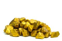 A pile of gold nuggets or gold ore on white background, precious stone or lump of golden stone, financial and business concept. Idea stock photo