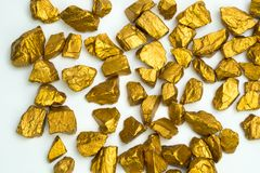 A pile of gold nuggets or gold ore on white background, precious stone or lump of golden stone, financial and business concept. Idea royalty free stock photography