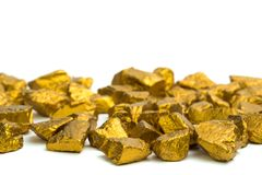 A pile of gold nuggets or gold ore on white background, precious stone or lump of golden stone, financial and business concept. Idea royalty free stock photos