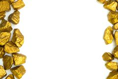 A pile of gold nuggets or gold ore on white background, precious stone or lump of golden stone, financial and business concept. Idea royalty free stock photo