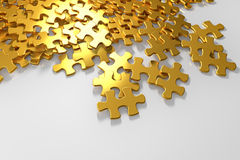 Pile of gold puzzle elements Royalty Free Stock Image