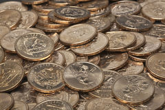 Pile of gold US dollar coins. With image of native american sacajawea Royalty Free Stock Photos