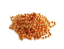 Pile of golden beads on a string Stock Photos