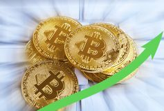 Pile of golden bitcoins with rising arrow.Decentralized virtual Stock Photography