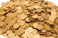 Pile of golden coins isolated. On white Stock Image