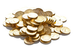 Pile of golden coins isolated on white Royalty Free Stock Images
