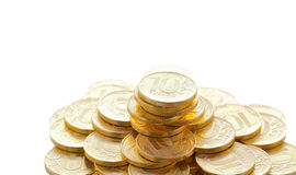 Pile of golden coins isolated on white Stock Photography