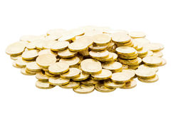Pile of golden coins isolated on white Royalty Free Stock Photos