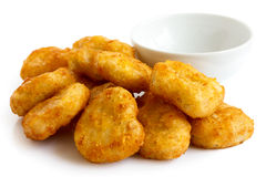 Pile of golden deep-fried battered chicken nuggets with empty bo Royalty Free Stock Image
